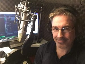Simon Morgan voice over artist in sound proof recording booth
